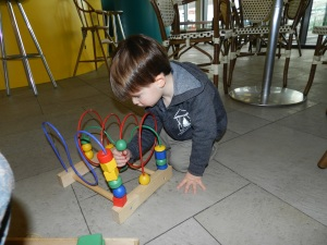 Of course he chose to play with an Ikea toy, the exact one that sits in his closet at home, with which he never play.